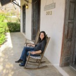 Relaxing on the front porch of the Adams Travis House.