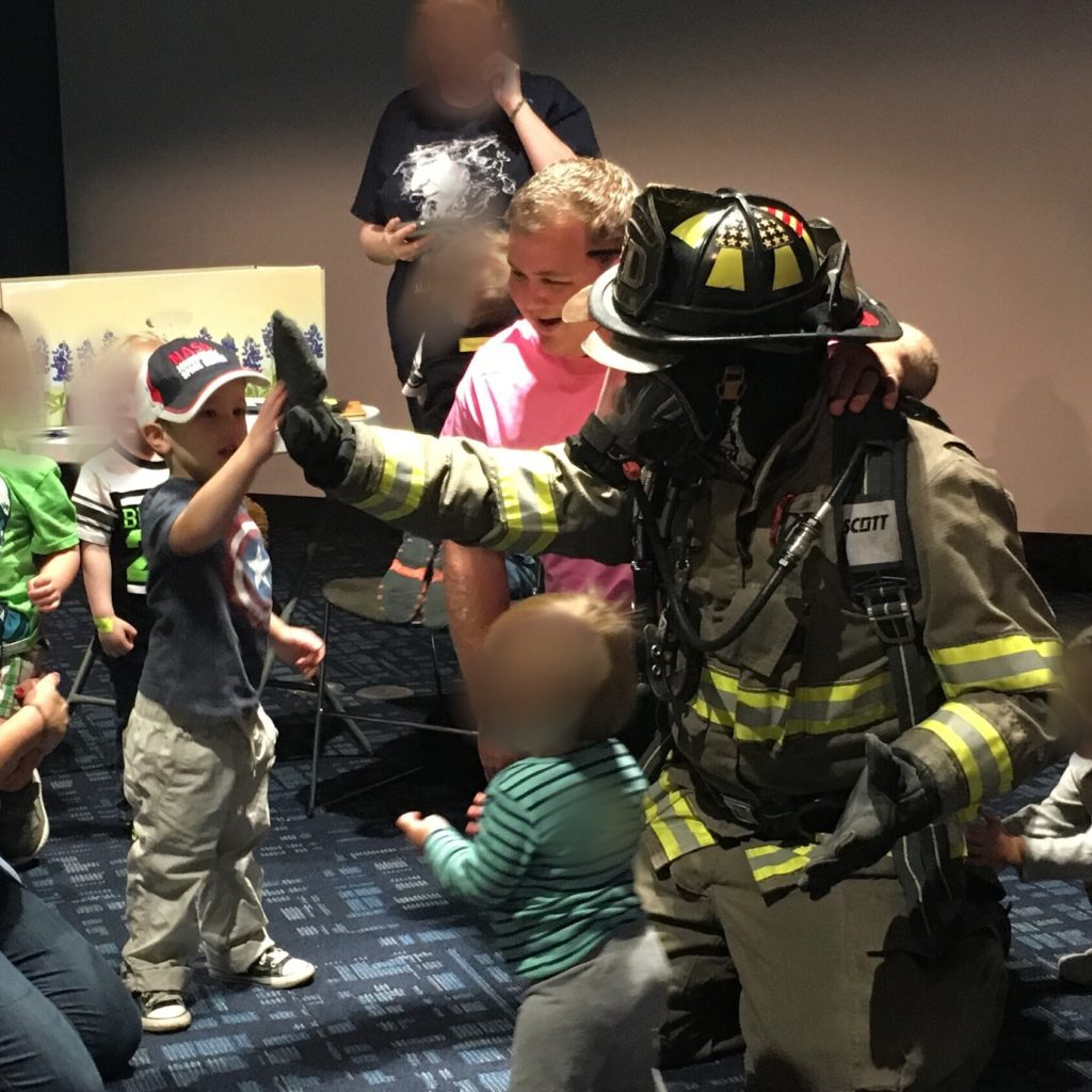 Gavin high-fiving a fireman | rainerlife.com