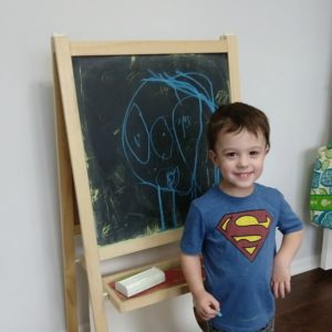 Gavin with his drawing of his mommy | rainerlife.com