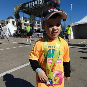 Gavin with his medal after the Freshie 1K | rainerlife.com