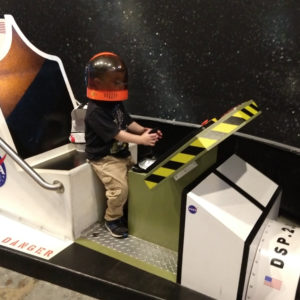 Gavin playing astronaut at Discovery Science Place | rainerlife.com