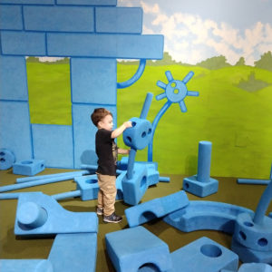Gavin playing at Discovery Science Place | rainerlife.com