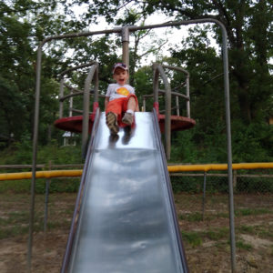 Gavin playing on a slide | rainerlife.com
