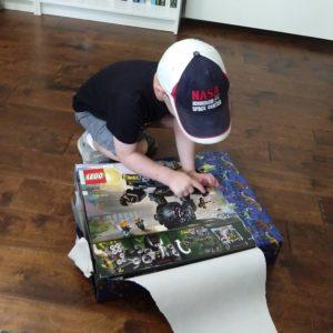 Gavin opening birthday presents | rainerlife.com