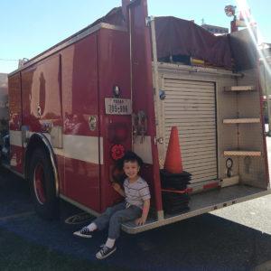 Gavin on a fire truck | rainerlife.com