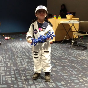 Gavin as an astronaut for Halloween at the library | rainerlife.com
