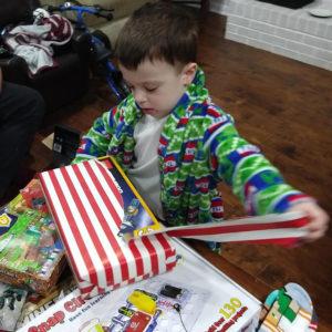 Gavin opening Christmas presents | rainerlife.com